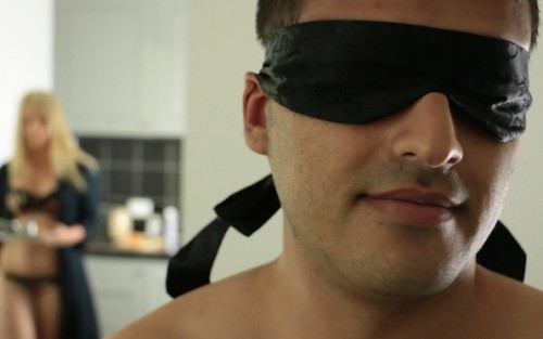 A man blindfolded in Taste, an erotic film by Louise Lush for Bright Desire