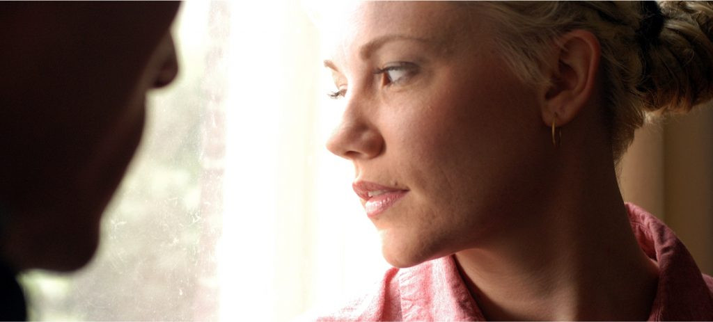 Alicia Whitsover gazing out window in Matinee, an erotic film directed by Jennifer Lyon Bell for Blue Artichoke Films