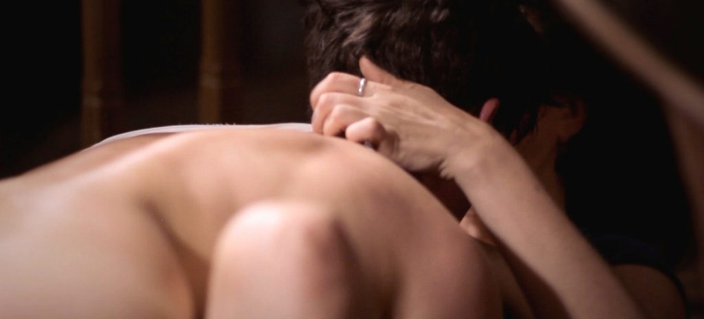 Sadie Lune scratches Parker Marx's back in Adorn, an erotic game film directed by Jennifer Lyon Bell for Blue Artichoke Films