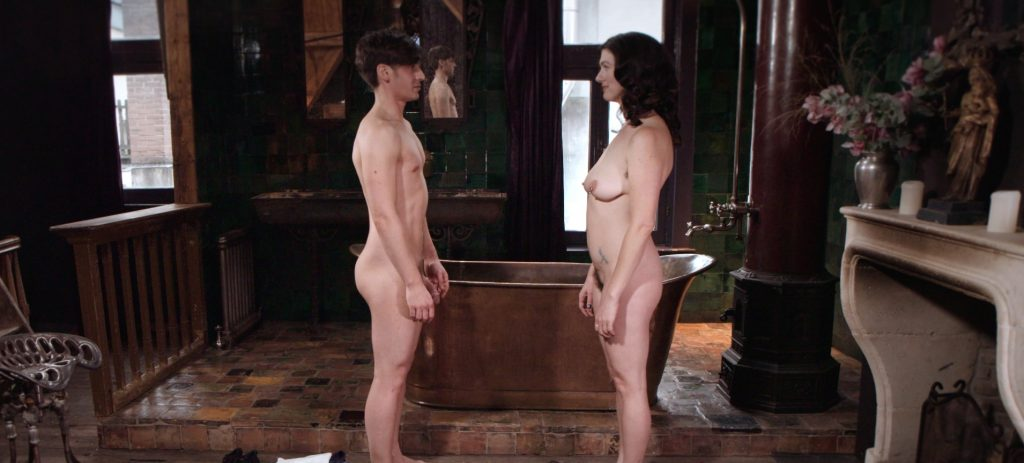 Parker Marx and Sadie Lune gaze at each other naked in the starting scene of Adorn, an erotic game film directed by Jennifer Lyon Bell for Blue Artichoke Films